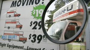 U-Haul truck seen in the side mirror of a another truck