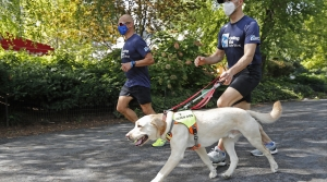 Blind man runs with guide dog