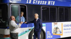 President Joe Biden participates in a tour of the La Crosse Municipal Transit Authority