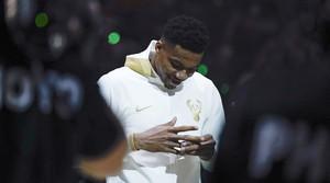 Read full article: Bucks get championship rings, beat Nets in season opener: 'It is insane'
