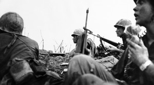American soldiers preparing for battle during the Vietnam War