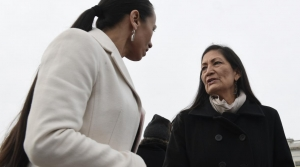 Rep. Deb Haaland, D-N.M., right, talks with Rep. Sharice Davids, D-Kan., left, as they arrive for a group photo