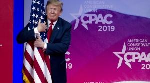 President Trump hugging a flag