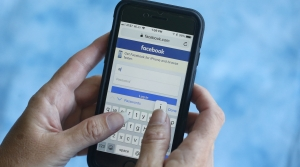 A smartphone user logs into Facebook