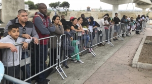 Asylum seekers wait in line in Tijuana, Mexico
