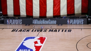 An empty court and bench are shown following the scheduled start time of Game 5 of an NBA basketball first-round playoff series