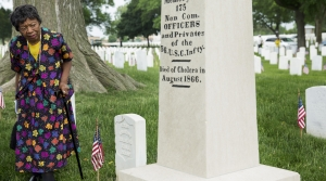 Edwina W. Lindsey looks at the grave marker of former slaves who fought in the Civil War