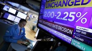 Employee works post on the floor of the New York Stock Exhange