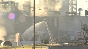 Workers hosing down Didion Milling Plant