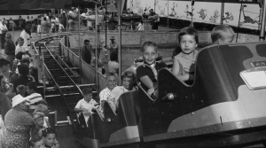 Children riding a roller coaster at the Wisconsin State Fair in West Allis