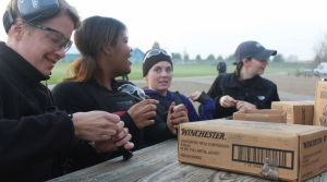 Madison Police recruits load rifle magazines before a training exercise.