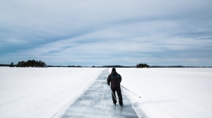 A person cross country skiing across a frozen lake