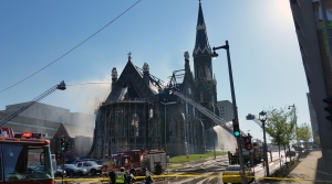 Firefighters spray church with water