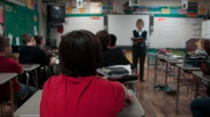 Students and a teacher in a classroom