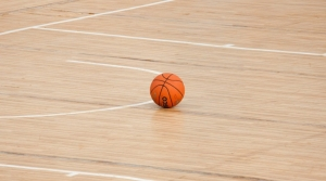 Basketball resting on court.