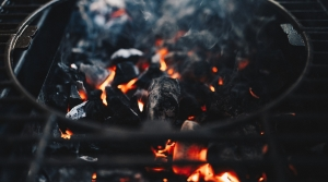 BBQ grill with flames and smoke.