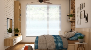 Bedroom with blinds at window and ceiling fan.