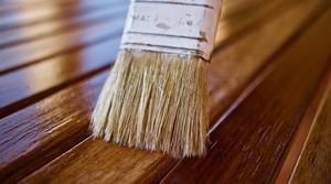 Paint brush on wood.