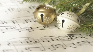 Bells and evergreens on sheet music.