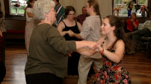 Two people contra dancing