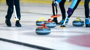 Curling competition on inside rink.