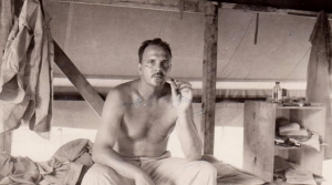 Frank Tachovsky resting on a bunk during World War II.