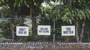 """Signs reading: """"Don't Give Up,"""" """"You Are Not Alone,"""" and """"You Matter"""""""