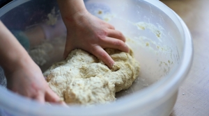 Kneading bread dough in a bowl