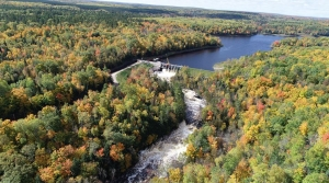 Breakwater Falls (Pine River Flowage) and the Pine River Dam during the peak of fall color.