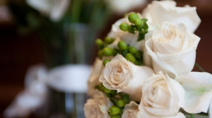 A wedding bouquet of white and light pink roses