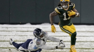 Read full article: Adams Shines In Snow As Packers Trounce Titans, 40-14