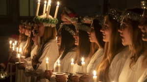 Young women sing carols