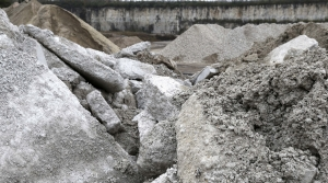 slabs of demolition concrete waste in a quarry