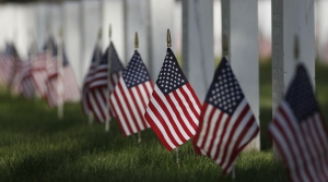 American flags mark the gravestones of military members
