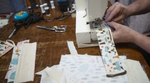 Tailor Derek Nye Lockwood sews face masks