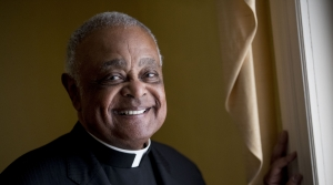 In this 2019 file photo, Washington D.C. Archbishop Wilton Gregory poses for a portrait following mass at St. Augustine