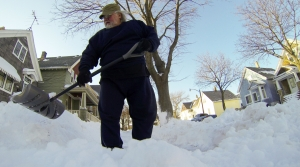 Bob Sam shovels his sidewalk Monday, Feb. 2, 2015 in Milwaukee