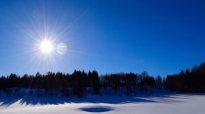 Sun rising over snow
