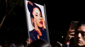 Fans with a photo of Selena during a ceremony honoring her in 2017. Over the decades since her death, Selena's legacy