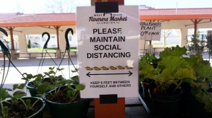 A sign from the opening last weekend of the West Allis Farmers Market