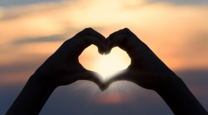 Hands shaping heart.