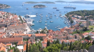 image of town and harbor from above with sailboats on water