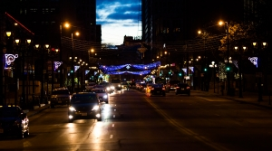 Cars drive at night in downtown Milwaukee.