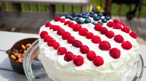 A cake with berries shaped like the American flag