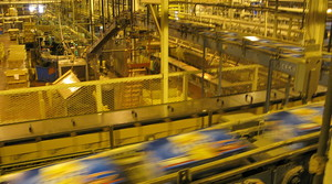 Beer on a conveyor belt at Molson Coors factory in Milwaukee