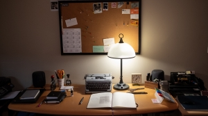 A desk setup with a lit lamp and office supplies on top and a bulletin board on the wall behind.