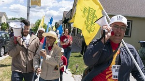 A delegation of immigrant essential workers marches their way through the city of Waukesha led by auto shop owner Hiram Rabadan.