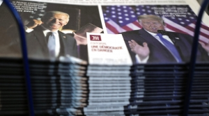 A stack of newspapers featuring Trump and Biden side by side on the front page.
