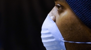A man wearing a face mask to prevent coronavirus transmission