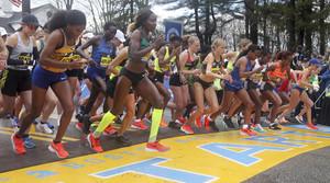 runners break from the start of the 123rd Boston Marathon